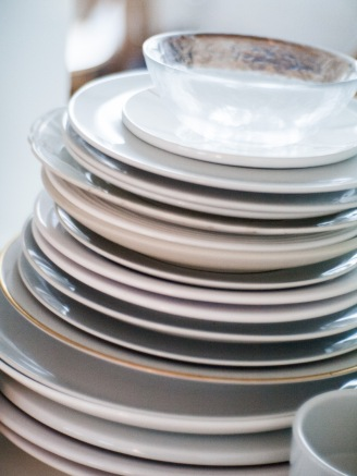 Stack of mostly white plates